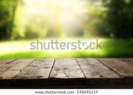 big wooden table and garden  - stock photo