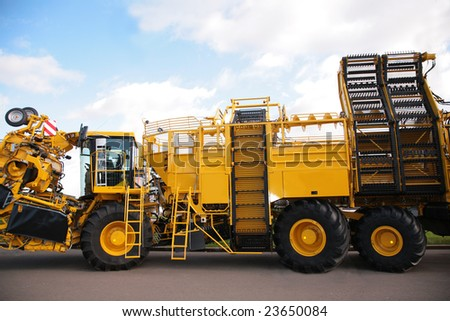 big yellow agricultural truck - stock photo