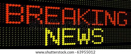 big yellow glowing electronic words breaking news - stock photo