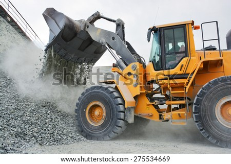 big yellow mining truck in quarry - stock photo