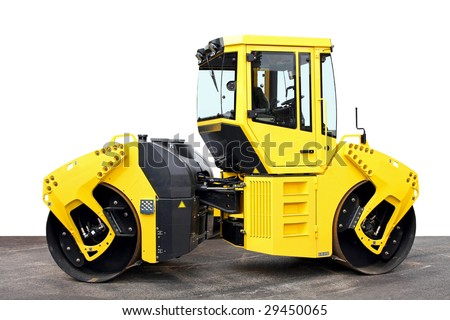 Big yellow road roller heavy construction machine - stock photo