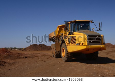 Big yellow truck with blue polarized background - stock photo