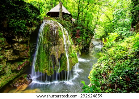Bigar waterfall is situated on 45 Parallel, in the forest of Anina Mountains, Romania and is formed by an underground water spring witch spectacular falls into the Minis River. - stock photo