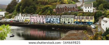 Biggest village on skye island, Portree with his colorful house near the Loch Portree, Scotland, UK. - stock photo