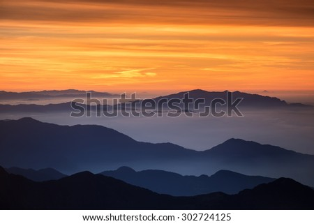 Bight and colorful high mountain landscape in haze. Captured at the high mountain pass in Himalayas.  - stock photo