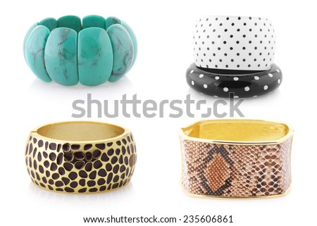 Bijou set: assorted bracelets isolated on white background. - stock photo
