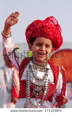 BIKANER, INDIA - January 10: An unidentified boy participates in Camel Festival on January 10, 2009 in Bikaner, Rajastan, India.  The festival takes place in January in Bikaner every year. - stock photo