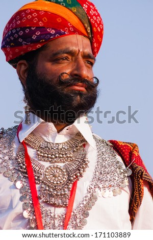 BIKANER, INDIA - January 10: An unidentified man participates in Camel Festival on January 10, 2009 in Bikaner, Rajastan, India.  The festival takes place in January in Bikaner every year. - stock photo