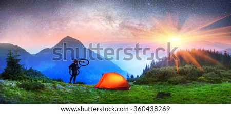 Bike adventure in the mountains, at different times of years- is extreme sports and outdoor recreation. In the Carpathians, the Alps and other mountain areas connected with this tourism industry - stock photo