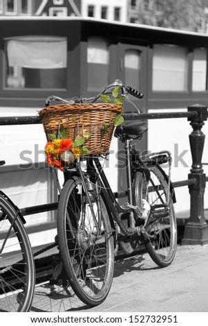 Bike against houseboat in Amsterdam, Netherlands - stock photo
