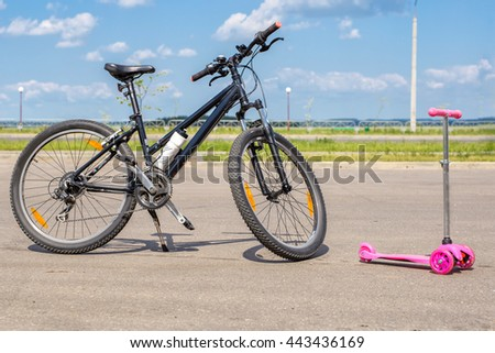 bike and scooter standing nearby - stock photo