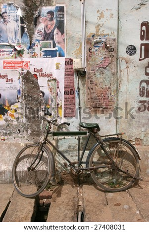 Bike backed by a wall of Tanjore - stock photo