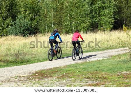 bike couple cycling outdoors - stock photo