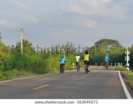 bike family on a street in Lampang , December 30,2015 Thailand - stock photo