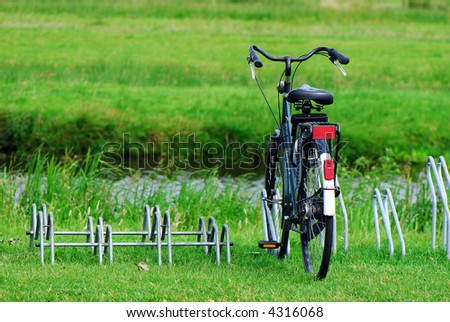 Bike in a green countryside field - stock photo