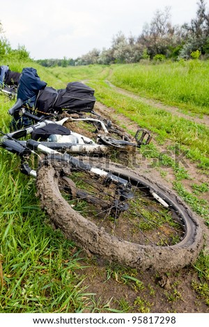 bike in dirt in countryside after rain - stock photo