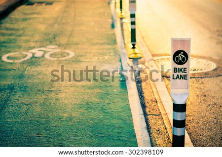 Bike lane in Bangkok city, Thailand. (Selective focus for shallow depth of field effect with golden warm light filter) - stock photo