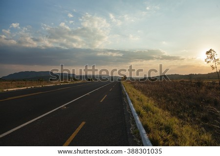 Bike lane on the side of a roadway at the sunset in Chapada dos Veadeiros, Brazil - stock photo
