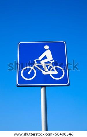 Bike lane traffic sign over blue sky - stock photo