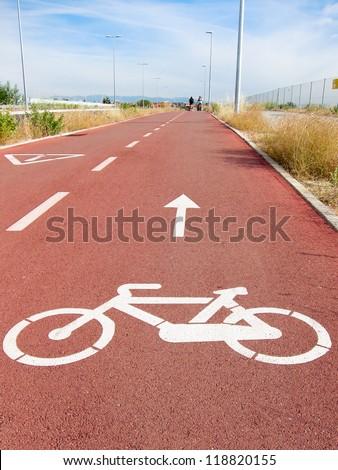 Bike lanes and white bike symbol in Madrid, Spain - stock photo