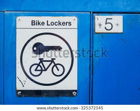 Bike locker sign at a suburban train station in Melbourne, Australia. - stock photo