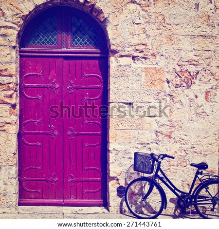 Bike near the Solid Wooden Door in the French City, Instagram Effect - stock photo