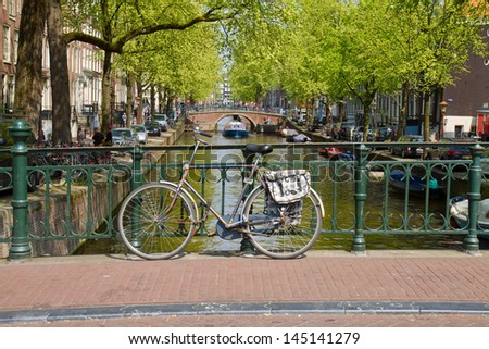 bike on a bridge,  canal ring of  Amsterdam, Netherlands