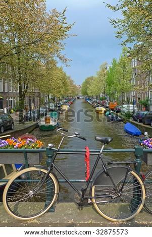 Bike on a canal bridge, Amsterdam, Netherlands - stock photo