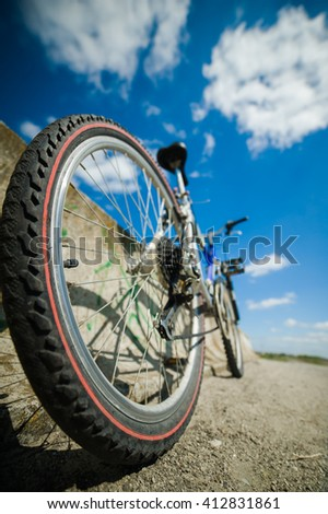 bike on a dirt road. back view - stock photo