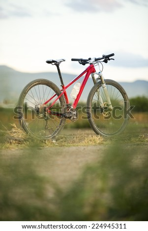 Bike on field - stock photo