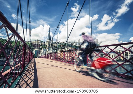 Bike on red footbridge - stock photo