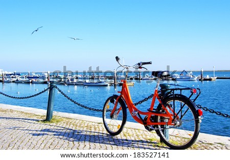 Bike parked along the port of Algarve sea - stock photo