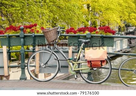 Bike parked on a bridge in Amsterdam, Netherlands - stock photo