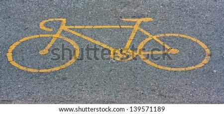 Bike Path Symbol Stencil'd on Asphalt (photograph) - stock photo