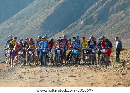 Bike race start in desert mountains - stock photo
