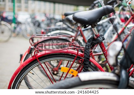 Bike rental service - Many bikes standing in bike stands, available for rent as a great mean of transport in the city - stock photo
