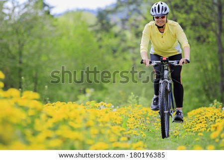 Bike riding - woman on bike - stock photo