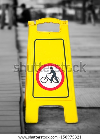 Bike sign plate on the walking way - stock photo