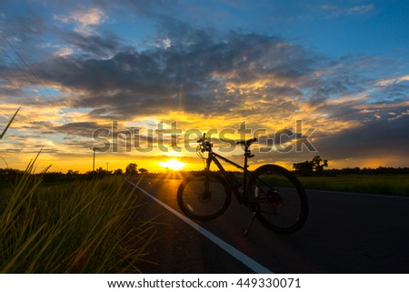 Bike Silhouette on a field with beautiful sunset