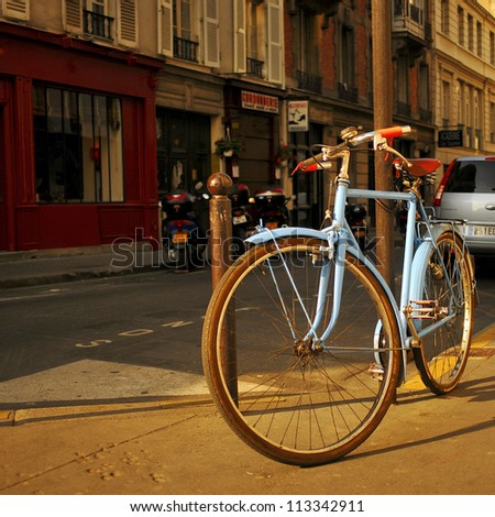 Bike standing on the street in Paris - stock photo