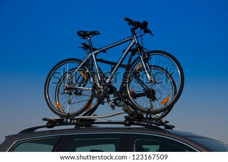 Bike transportation - two bikes on the roof of a car - stock photo