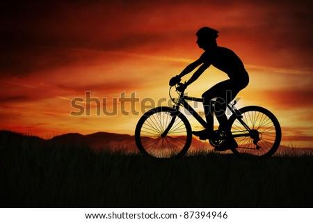 Bike trip sunset - stock photo