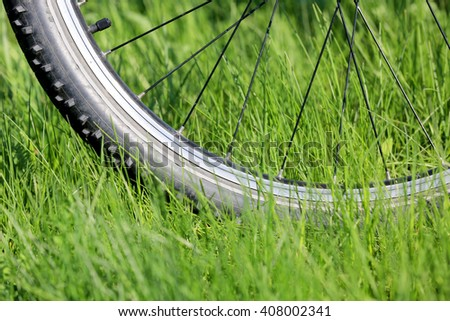 bike wheel on green grass meadow