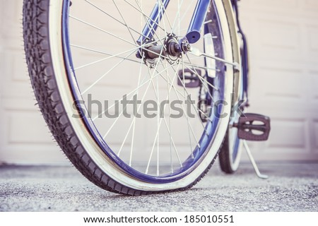 Bike with a flat tire, shallow focus - stock photo