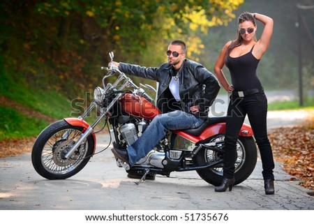 Biker and an attractive girl - stock photo