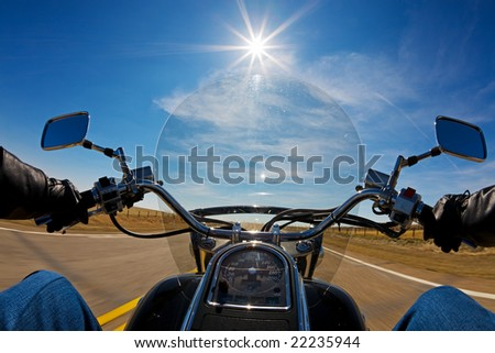 Biker enjoying a ride in the country side on a sunny day - stock photo