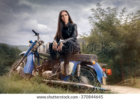 Biker Girl in Leather Jacket on Retro Motorcycle - Portrait of a cool woman on a vintage motorbike