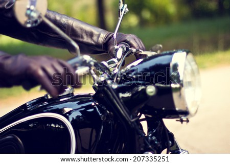 Biker girl sits on a motorcycle  - stock photo