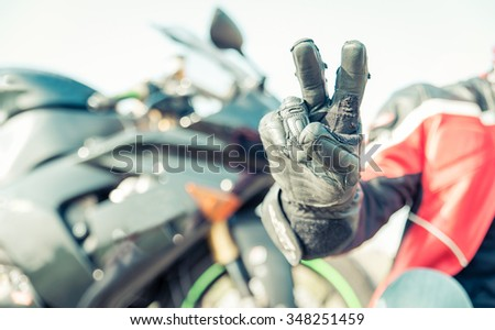 Biker greeting with the fingers. Concept about motorcycles and sport - stock photo