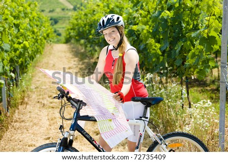 biker holding a map in vineyard, Czech Republic - stock photo
